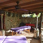 Unforgettable creekside massage room with heat lamps