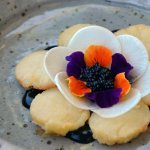 Semolina scallops, squid ink, radish, flowers, avruga cavier