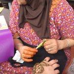Henna artist at work.