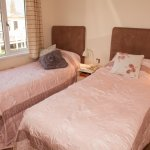 Twin bedroom with cosy feather and down duvets and fitted wardrobe