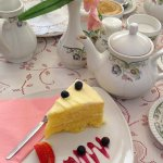 Cake beautifully presented and tea in China cups