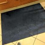 Dirty and stained rug and sticky tile. Employee just excused because they are just to busy...