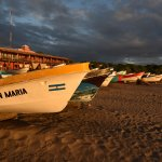 Boats on beach with hotel