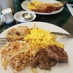 2 scrambled eggs w/cheese, sausage, hash browns and fruit scone.