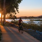 Cycling along the Bluewater Trail at sunset beside the Pioneer River.