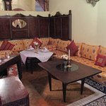The restaurant, traditional low sofas around a low table.