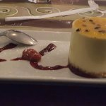 Passion fruit cheese cake served with a bonus of ice cream and cookie