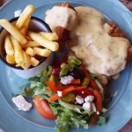 Chicken schnitzel with cheese sause