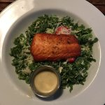 This is the Kale And Brussel sprout salad. Hold the almonds, add salmon, dressing on the side