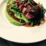 Rump of spring lamb, herb gnocchi, fine beans, pea purée and jus of lamb.