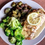 Grilled Salmon with lemon sauce, steamed broccoli, pesto potatoes.