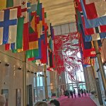 Flags in the entry hall & spectacular stained glass window