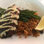 Blackened redfish with jambalaya and grilled asparagus