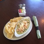 Spinach Artichoke Dip topped with sautéed shrimp.