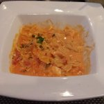 Farfalle Al Salmone -Chunks of salmon sautéed with onions in pink cream sauce tossed with farfal