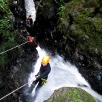 First canyoning experience moments before being submerged under the waterfall