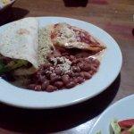 Chorizo taco and enchiladas with pintos