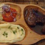 Steak, potatoes, and salad