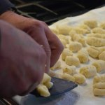 Use a kitchen towel, not paper or an unlined pan to hold the gnocchi while you are finishing