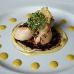 Scallops with a parmesan potato scone, sweetcorn purée and truffle cream