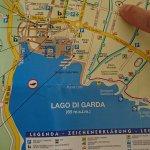 Pointing to Villa Nicolli on a map of Riva del Garda