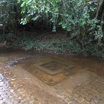 One of the numerous 'lingams' carved into the river bed