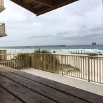 Beach from picnic table on balcony patio on doggie floor. M.B. Miller County Pier in background.