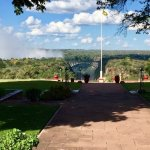 View of the Victoria Falls Bridge and the thundering clouds of water mists from the Falls