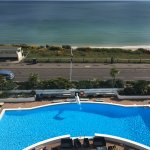 View from our balconies overlooking sea and pool