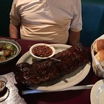 Huge rack of ribs shown, baked beans, salad, yeast rolls, soup already eaten