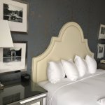 Mirrored side tables, modern headboard, metallic accents