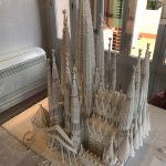 A model of the Sagrada Familia that's displayed at Gaudi's house in Park Güell and a view of the
