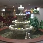 Fountain in lobby with Lounge in background.