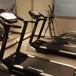 The fitness room had two treadmills and an ellipsis machine.