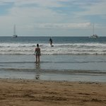 Surfers and Boats off Tamarindo, Costa Rica.