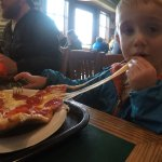 Ethan loving the Pepperoni Pizza! He ate the entire slice!