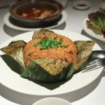 Steamed rice with preserved Chinese sausages wrapped in lotus leaf