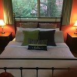 Kookaburra's loft bedroom has a comfortable bed and great views to the garde