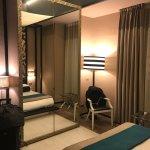Dharma Hotel & Luxury Suites Photo