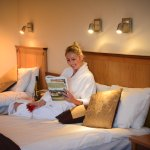 Relaxing in Hotel Bedroom