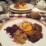Traditional duck with red and white cabbage and lokse (pancake made of potato dough)