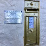 Olympian dedicated letter-box set in the pub wall