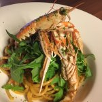Bucatini pasta with langoustine, home-made red pesto sauce, topped with fresh rocket.
