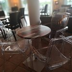 Plastic chairs in the bar area.