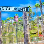 Railroad signs tells travelers they've arrived in San Clemente.