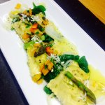 Homemade seafood giant ravioli with Exmoor asparagine and wild garlic