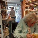 Kath eating. Jams and Chutneys on display