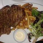 Rib steak with fries and salad paired with red wine for $29 (special).