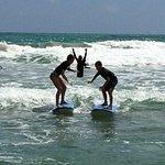 Brother and sister riding waves together