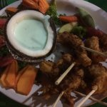 Coconut shrimp with dip in coconut shell